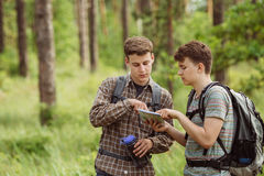 Two tourist determine the route map and compass Stock Image