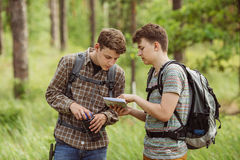 Two tourist determine the route map and compass Royalty Free Stock Photo