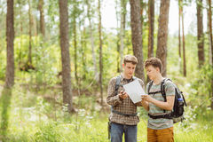 Two tourist determine the route map and navigator Stock Photo