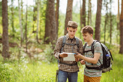 Two tourist determine the route map and navigator Royalty Free Stock Photo