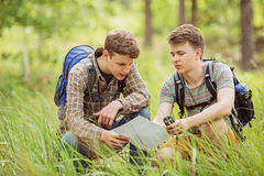 Two tourist determine the route map and navigator Royalty Free Stock Image