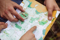 Two tourist determine the route map and navigator Stock Photography