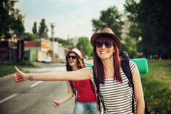 Two Tourist Girl Hitchhiking Royalty Free Stock Photography