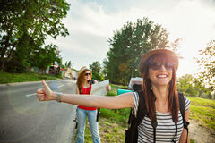 Two Tourist Girl Hitchhiking Royalty Free Stock Image