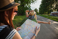 Two Tourist Girl Hitchhiking Stock Images