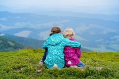 The two tourist girls. Two tourist girls and mountain views. Carpathians,  Ukraine. beautiful landscape royalty free stock photography