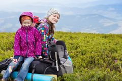 The two tourist girls. Two tourist girls and mountain views. Carpathians,  Ukraine. beautiful landscape stock image