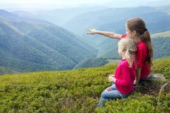 The two tourist girls. Two tourist girls and mountain views. Carpathians,  Ukraine. beautiful landscape stock photography
