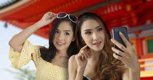Two tourist girls take selfie photo royalty free stock photos