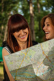 Two Tourist Girls Using Map Stock Photos