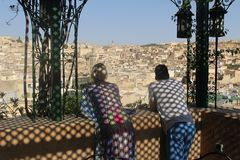 Two tourists gaze over the ancient medina of Fes Morocco Stock Photography