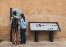 Two tourist read guiding map of Kasbah of the Udayas stock photography