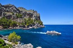 Two tourist ships cruising the coastal sea. Two tourist ships cruising blue sea near Sa Calobra on the island of Majorca royalty free stock photo