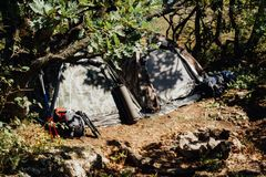 Two tourist tents in the forest in the camp. Two tourist tents with decomposition tourist equipment day in the woods around the camp fire royalty free stock image