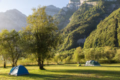 Two tourist tents in  mountains. Alps. Switzerland. Stock Photography