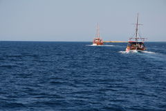 Two tourist wooden boats in the Aegean Sea. Tourist wooden boat in the Aegean Sea. Greece Stock Photos