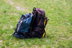 Two touristic backpacks on the green grass. Concept of travel and active lifestyle Stock Photography