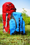 Two touristic backpacks on the meadow Royalty Free Stock Image