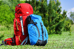 Two touristic backpacks on the meadow Stock Photos