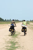 Two tourists in bicycle trip. View from back Stock Images