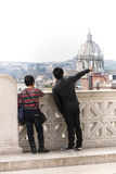 Two tourists couple in Rome. Man pointing dome church. Stock Photos