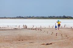 Two tourists among flat plain, steppe, salt, salt lake, heat and Stock Photography