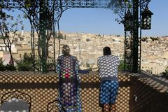 Two tourists gaze over the ancient medina of Fes Morocco Stock Photos