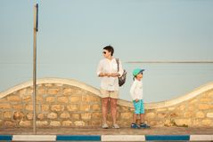 Two tourists are looking for the correct way. Island Djerba, Tunisia. Morning time. Two tourists looking about, mother and her son of 6 years, try to find the Royalty Free Stock Photos