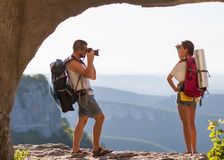 Two tourists. Man photographs woman Stock Photo