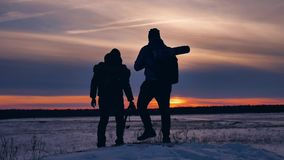 Two tourists photograph the sunset mountains silhouette of nature. tourists people group go travel nature outdoors. Two tourists photograph sunset mountains stock video