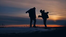 Two tourists photographer silhouette of sunlight man nature landscape winter snow. two male photographers travel stock footage