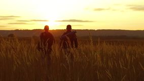 Two tourists silhouettes. Two tourists go at sunset. Tourist nature silhouette nature slow motion video. Two tourists silhouettes. Two tourists go sunset stock footage