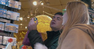 Two Tourists in Souvenir Shop stock footage