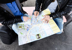 Two tourists are trying to search for a place to go Royalty Free Stock Photography