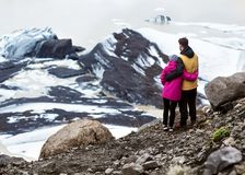 Two tourists will be on an iceberg in Iceland stock photos
