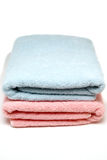 Two towels. Blue and pink towels for male and female genres royalty free stock images