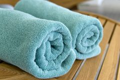Two towels braided in a tubule on chair. Two towels  braided or curtailed in a tube on the wood chair Royalty Free Stock Photo