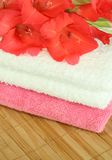 Two towels and gladiolus Stock Photo