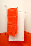 Two towels are in an orange bathroom Stock Photos