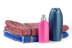 Two towels and two bottles Stock Photo