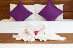 Two Towels on White Bed Sheet Royalty Free Stock Image