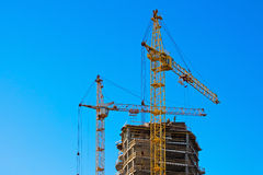 Two tower cranes building. Working blue sky Stock Photo
