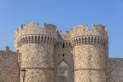 Two tower of Greek castle Rhodes old medieval gate with blue sky. On sunny day Royalty Free Stock Images