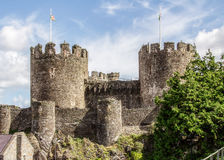 Two Towers of Conwy Castle. Image of the Two Towers of Conwy Castle in North Wales, complete with flag poles displaying the Welsh Dragon Stock Photography