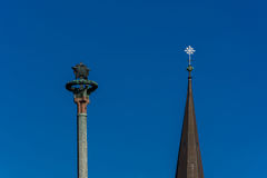 Two towers, cross & Soviet star on a background of blue sky. The cross and the Soviet star on the top two monuments, in the blue sky Royalty Free Stock Image