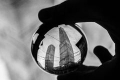 Two towers, Garisenda and Asinelli family  in Bologna,  in a crystal ball Royalty Free Stock Image