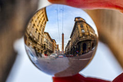 Two towers, Garisenda and Asinelli family  in Bologna,  in a crystal ball Royalty Free Stock Photos