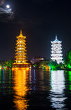 Two towers in Guilin in China with moonlight sky Stock Photos