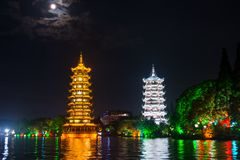 Two towers in Guilin in China with moonlight sky Stock Photography