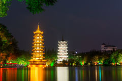 Two towers in Guilin China at night Stock Photos